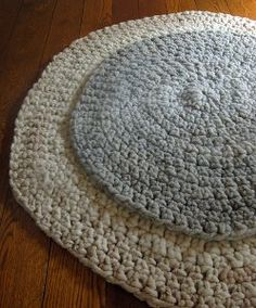 Big Stitch Alpaca Rugs will warm cold floors during the long winter months. Single crochet stitches are used to create these simple, but large, circular rugs. They will make any room of your home cozier.