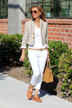 White jeans with a slim, camel-colored leather belt, a white V-neck t-shirt, a simple jacket, and loafers.