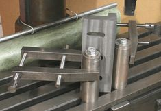Cylindrical squares, cut same height as bottom of vise jaws, use as outrigger