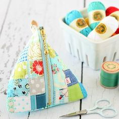 Put your fabric scraps to good use in this Patchwork Triangle Pouch - featuring 1.5 inch squares.