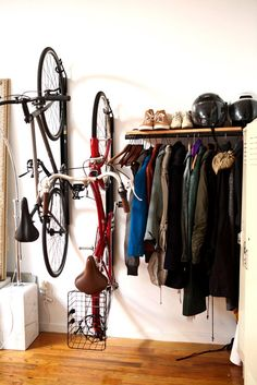 "Neat way to hang bikes in a ""mudroom"" area. Love the open shelf for shoes, jackets. Could add those rock trays below for wet shoes."