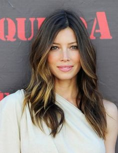 Perfectly Sun-Kissed Hair for a Brunette and great layers/waves. And nice lip color. by evangeline