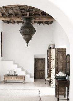 """BBC Boracay says: """" Here rustic wood - ceiling and doors - meets clean white hand washed walls. Great contrast in structure and color. Fantastic the high ceiling and the bright day light. Highlight - the antique Moroccan lamp """""""