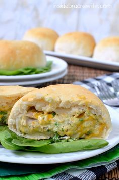 Spinach Artichoke Chicken Biscuits - spinach, artichoke, chicken, and 3 kinds of cheese baked inside a Pillsbury grands biscuit