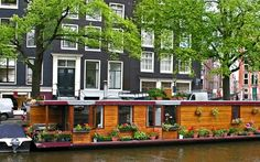 Houseboat in Amsterdam, Netherlands. i would love this to be my house one day