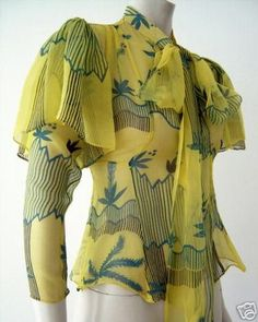 Ossie Clark Blouse 70s designer graphic novelty print yellow blue ruffle bow shirt retro repro look 30s style influence