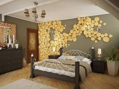 slices of lumber, in pale yellow, decorating a gray wall, inside bedroom with laminate floor, dark brown furniture, and bed with wrought iron frame