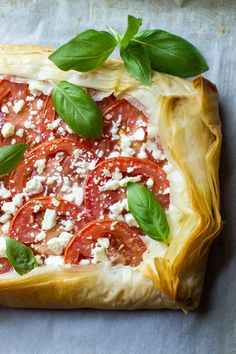 This Mozzarella Tomato Tart has a butter-garlic phyllo crust with mozzarella, tomatoes, feta, and basil. Makes a great appetizer or light meal for summer! Nothing beats the fresh tomatoes of summer. Phyllo Dough Recipes, Puff Pastry Recipes, Tart Recipes, Cooking Recipes, Great Appetizers, Healthy Appetizers, Appetizer Recipes, Dinner Recipes, Phyllo Appetizers