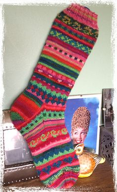 This is a monster sock pattern to use up remnants of sock yarn left over from other projects. Pattern is largely written with small sections of charted colorwork. Socks are a standard 64 stitch pattern. Fair Isle Knitting, Loom Knitting, Knitting Socks, Hand Knitting, Knitting Patterns, Crochet Socks, Knit Mittens, Crochet Yarn, Yarn Projects