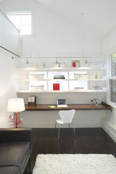 Love the long simple bench (though it should be white to match the shelves) and backlighting behind the shelves