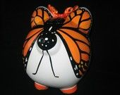 butterfly piggy bank!                                                                                                                                                                                 Más
