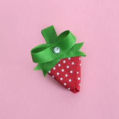 Offray Ribbon Projects | Sweet and adorable describes this cute strawberry hair clip! Get ready for spring by creating this easy hair clip in red and pink ribbon.