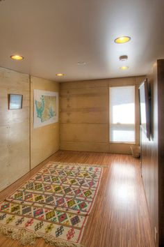 Here is an image of the guest room when the walls are fully closed. The wall that the painting hangs on folds down to reveal a Murphy bed.