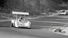 Jim Hall in his 2G has passed both McLaren M8A cars to take the lead at Bridgehampton, 1968. Both McLarens would eventually drop out and Hall would suffer a stuck fuel injection valve that cost him power for nearly 1/3 of the race. Donohue would get by and open a 30 second lead. The fuel injection valve unstuck itself, restoring full power. Hall took off after Donohue, taking big chunks off his lead, but ran out of laps and had to settle for 2nd. Stan Rosenthall photo.