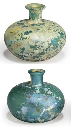 TWO SASANIAN GLASS BOTTLES   CIRCA 3RD-5TH CENTURY A.D.   Each blue-green in color, free blown, with a globular body on a slightly concave base, with a short cylindrical neck, the disk rim folded in  Taller: 2 15/16 in. (7.4 cm.) high (