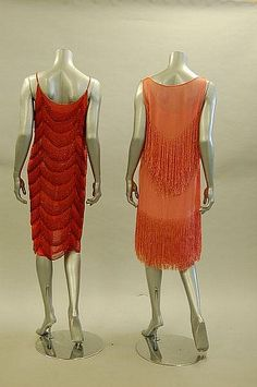 Two flapper dresses (back), 1920s. Left: Watermelon-pink chiffon with tiered beaded panels. Right: Pale pink chiffon with beaded fringe and matching slip.