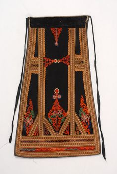 Karagounian outradenia apron made of black felt, ornamented with woven bought bands and zig-zag braids , Trikala