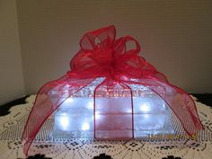 Holiday Red Ribbon on Frosted glass block by Originalsbysuej