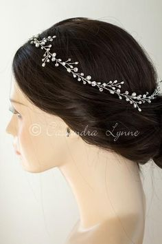 A simple and stunning wedding hair vine of round rhinestones and natural freshwater pearls. This headpiece could be worn as a halo or woven into your bridal hai