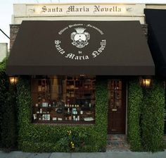 Santa Maria Novella, Luxurious Italian Beauty And Healthcare Brand Available In LA Café Restaurant, Restaurant Design, Cafe Design, Store Design, Santa Maria Novella, Small Cafe, Cafe Shop, Lovely Shop, Shop Fronts