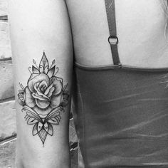 Black and white rose tattoo on the back of the arm.