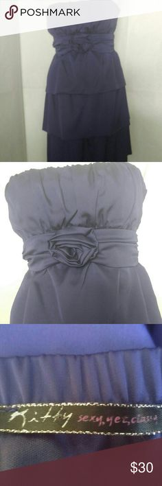 Kitty purple strapless cocktail dress Classy yet sexy, this is a strapless cocktail dress by Kitty. In lovely royal purple, this strapless dress features 3 tiered skirt, hidden side zip, a rosette at waist, and a sash which ties in back. 100% polyester. Size small. In excellent used condition (no rips, tears, pulls, or visible stains.) Kitty Dresses Mini