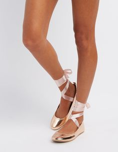 Keep your style on point in these beautiful ballet flats! Faux leather shapes the round toe silhouette, with a pair of satin straps that lace around the ankle and tie into a dainty bow on top. Style: RAYANATie closure at ankleLightly cushioned insoleNon-skid rubber soleBrand: Charlotte Russe