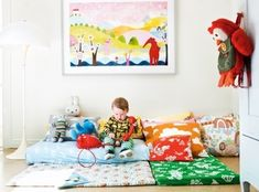 the sweetest room i've seen for a toddler. nice mix of colorful prints and mats (and no crib) montessori-style.