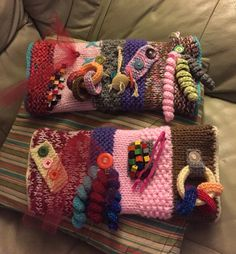Two more twiddle muffs knitted with crochet bits and pieces