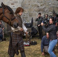 outlander_starz @SamHeughan certainly knows how to work the camera! #Outlander #BehindTheScenes | Making it look easy in the midst of filming and production staff