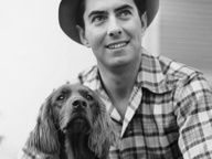 Vintage B photo of legend Tyrone Power with his dog