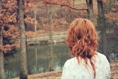This redhead beauty fits into this fall scene perfectly.