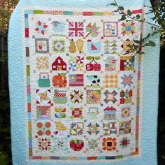 My Farm Girl Vintage quilt has been quilted and bound for months.  And the sun is shining on it today.