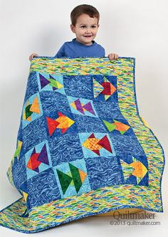 """Fancy Fishies Foundation-pieced fish float across this colorful crib quilt. Designed by: Eileen Fowler, QM Associate Editor Skill Level: Easy Technique: Foundation Piecing Size: Crib, 38""""x 38"""" Click to download the complete pattern for Fancy Fishies (PDF file). This is the fifteenth pattern Quiltmaker has published in support of Project Linus, an organization that provides …"""