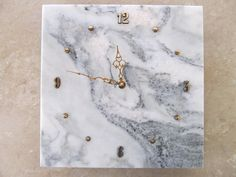 Elegant white and green marble wall clock    Stone: Crystal Stratus marble from Vermont, USA. Hand Color: Gold    Numbers: Gold one inch tall raised