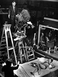 Stanley Kubrick and film crew set up a shot with actress Tracy Reed; during production of Mr. Kubrick's Dr. Strangelove, or: How I Learned to Stop Worrying and Love the Bomb (1964)