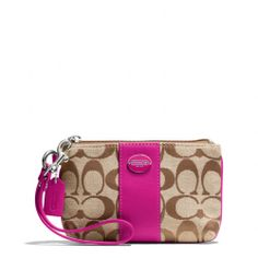 The Legacy Small Wristlet In Signature Fabric from Coach You can never have too many Coach wristlets!