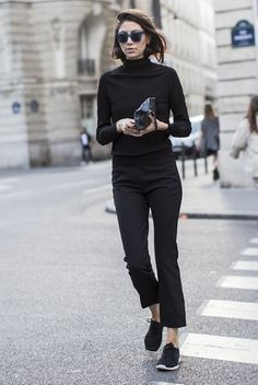 black mock turtleneck, cropped black pants, black sneakers