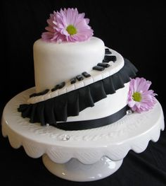 Nix the pedestal and gerbera daisies and this is a great cake :)