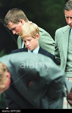 Royal Family, Balmoral Estate, Scotland, 5th September 1997. After attending a private service at Crathie Church, Royal family stop to look at floral tributes left for Princess Diana, at the gates of Balmoral Castle. Prince Charles Prince Harry Peter P Stock Photo