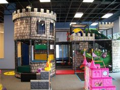 Castle themed indoor playground structure by International Play Company. http://www.internationalplayco.com/