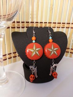 Lone Star beer cap earrings with guns and skulls now available at our Etsy Shop