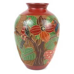 7 inch Tall Relief Vase - Tree of Life - Esperanza en Accion This decorative vase from Nicaragua is 7 inches tall and inches in diameter, featuring a tree if life relief design. This is low fired and not designed to hold water. Indian Ceramics, Linens And More, Tall Vases, Pottery Vase, Handmade Pottery, Vases Decor, Tree Of Life, Artisan, Creations