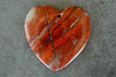 Gorgeous, designer stone pendant is genuine Rainbow Jasper.  All natural, no enhancements of any kind.  Beautiful colors of red, with some tan, and black.  The shape is a heart, and the cut is perfect, with nice clean edges and drill hole, drilled from front to back.  The stone is rounded on the front, and flat on the back. Gorgeous, designer quality stone.  Stone measures 45x45x5mm.  Gemstone pendant is all natural, and one of a kind.    Please check my other listings…