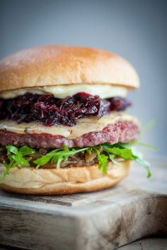 Classic Living Space burger in a brioche bun with mayo, cheese, cararmelised…