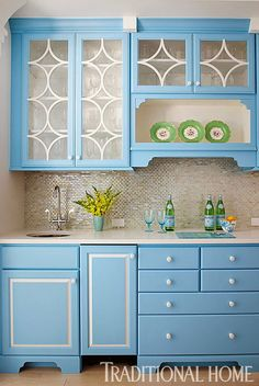 Bright Blue Cabinets In The Kitchen Makes This Kitchen Light And Cheerful.