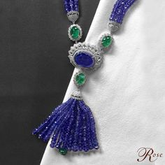 Inspired from the early 1900's Sautoir style, this exquisite neckpiece showcases a rare Tanzanite cabochon, nestled in fancy Diamonds, faceted Emeralds and Tanzanite beads, only from @thehouseofrose  Experience our special collection at the 14th Gold & Jewelry Exhibition from April 25-30th at Booth 160, Hall 8, Mishref, Kuwait.  #luxury #jewellery #kuwait #showcase #exclusive #jewelry #jewels #emerald #diamonds #tanzanite #gold #cabochon #tassel #womenstyle #bijoux #style #bespoke…