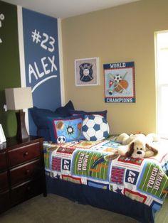 contemporary sports theme boys bedroom by klang associates