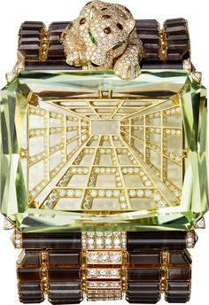 "CARTIER. {Close up} ""Narcisse"" Panthère Bracelet - yellow gold, one 167.64-carat octagonal-shaped light yellowish green beryl, brown obsidian, pear-shaped tsavorite garnet eyes, onyx, brown and white brilliant-cut diamonds.."