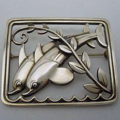 Jensen dolphins silver brooch